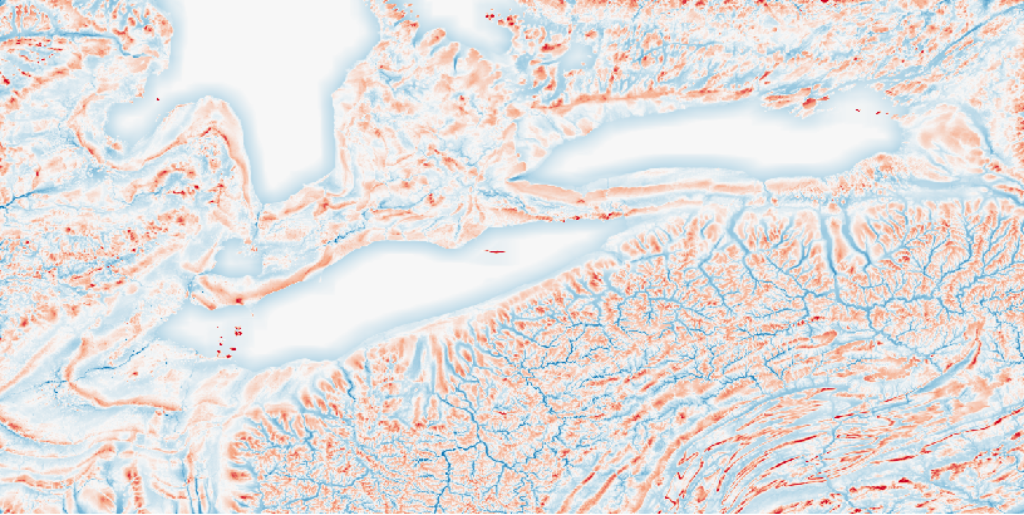 A measure of local topographic position. certain topographic features that are emphasized as either locally low-lying (negative values in blue) or locally elevated (positive values in red) at this scale. Features, like bedrock folds, eroded river valleys, and depositional moraines, are all evident in this image.